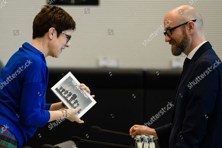 The Secretary General of the Christian Democratic Union (CDU) Annegret Kramp-Karrenbauer (L) shows a copy of the book 'We are coming - Alfred Dregger and his team' (Wir kommen - Alfred Dregger und seine Mannschaft) to State secretary at the Defense Ministry, Peter Tauber (R) speak with each other prior to the start of a CDU/CSU faction meeting at the German 'Bundestag' parliament in Berlin, Germany, 16 October 2018. The Christian Democratic Union (CDU) and Bavarian Christian Social Union (CSU) parties faction meeting took place two days after the regional election in the German state of Bavaria in which the ruling CSU party suffered significant losses.
