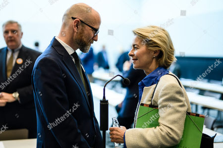State secretary at the Defense Ministry, Peter Tauber (L), and German Defense Minister Ursula von der Leyen (R) speak with each other prior to the start of a CDU/CSU faction meeting at the German 'Bundestag' parliament in Berlin, Germany, 16 October 2018. The Christian Democratic Union (CDU) and Bavarian Christian Social Union (CSU) parties faction meeting took place two days after the regional election in the German state of Bavaria in which the ruling CSU party suffered significant losses.