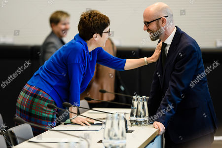 The Secretary General of the Christian Democratic Union (CDU) Annegret Kramp-Karrenbauer (L) and State secretary at the Defense Ministry, Peter Tauber (R) speak with each other prior to the start of a CDU/CSU faction meeting at the German 'Bundestag' parliament in Berlin, Germany, 16 October 2018. The Christian Democratic Union (CDU) and Bavarian Christian Social Union (CSU) parties faction meeting took place two days after the regional election in the German state of Bavaria in which the ruling CSU party suffered significant losses.