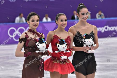 Gold medalist Alina Zagitova, center, silver medalist Evgenia Medvedeva both of Russia pose with bronze medalist Kaetlyn Osmond of Canada, right, during the awards ceremony for the Ladies Figure Skating Free Skating finals at the Pyeongchang 2018 Winter Olympics.