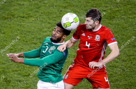 Stock Photo of Republic of Ireland vs Wales. Ireland's Cyrus Christie with Ben Davies of Wales