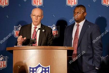 Rich McKay, Atlanta Falcons CEO and chairman of the NFL Competition Committee, left, and Troy Vincent, the NFL's executive vice-president of football operations, speak to reporters at the NFL fall meetings in New York