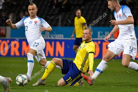 Sweden's John Guidetti (C) fights for the ball with Slovakia's Stanislav Lobotka (L) and Milan Skriniar (R) during the International friendly soccer match between Sweden and Slovakia at Frimds Arena in Stockholm, Sweden, 16 October 2018.