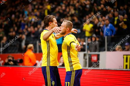 Stock Picture of Sweden's John Guidetti (R) celebrates with teammate Albin Ekdal after scoring the 1-0 lead during the International friendly soccer match between Sweden and Slovakia at Frimds Arena in Stockholm, Sweden, 16 October 2018.