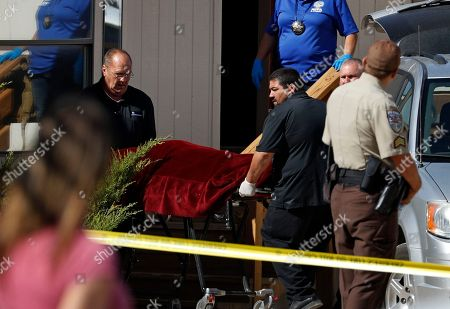 Authorities remove the body of Nevada brothel owner Dennis Hof from the Love Ranch brothel, in Pahrump, Nev. Hof, a legal pimp and Republican candidate. died Tuesday Nevada Authorities said