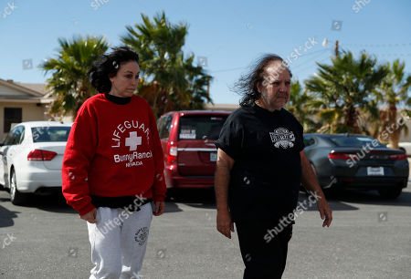 Ron Jeremy, right, and Heidi Fleiss walk out of the Love Ranch brothel, in Pahrump, Nev. Dennis Hof, a legal pimp and Republican candidate has died at the brothel according to Nevada Authorities