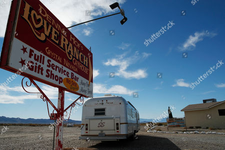 Stock Photo of A sign advertises the Love Ranch outside of the brothel, in Pahrump, Nev. Dennis Hof, a legal pimp and Republican candidate has died at the brothel according to Nevada authorities