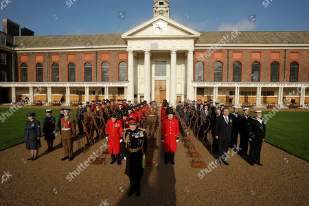 Stock Photo of British General Lord Richard Dannatt, front center, the retired former Chief of the General Staff, head of the British army, poses for a group photograph with Chelsea Pensioners, serving soldiers, serving airmen and women, Royal Navy reservists, military veterans and 6 foot 'Tommy' figures at the Royal Hospital Chelsea in London, for the 'There But Not There' campaign to commemorate the upcoming centenary of the end of World War I, . World War I ended on November 11, 1918 and 'There But Not There' is the 2018 Armistice project for the charity Remembered