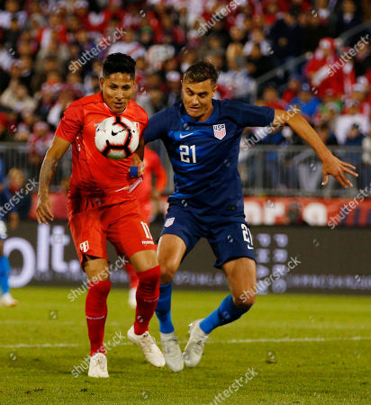 Peru forward Raul Ruidiaz (L) controls the ball as United States defender Aaron Long (R) defends during the first half of the friendly match between the United States and Peru at Pratt and Whitney Field in East Hartford, Connecticut, USA, 16 October 2018.