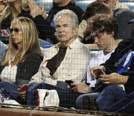 US actor Warren Beatty (C) and his son Stephen (R) attend the National League Championship Series baseball game four between the Milwaukee Brewers and the Los Angeles Dodgers at Dodger Stadium in Los Angeles, California, USA, 16 October 2018.