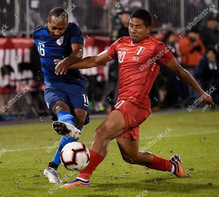 United States' Julian Green (16) kicks as Peru's Edison Flores (20) defends during the second half of an international friendly soccer match in East Hartford, Conn