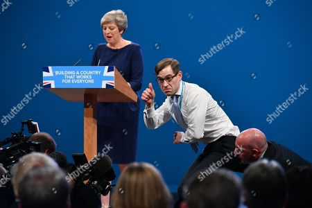 Theresa MayLobby- 4/10/17 Stunt Comedian Simon Brodkin (aka Lee Nelson ) After Handing Prime Minister Theresa May A P45 Form During Her Keynote Speech On The Fourth And Final Day Of The Conservative Party Conference At The Manchester Central Convention Centre . Brodkin Said Boris Johnson Told Him To Do It.