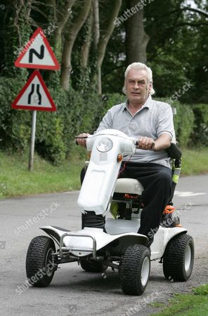 Editorial image of Peter Bright, convicted of drink driving while using his mobility scooter along the A140 at Long Stratton, Norfolk, Britain - Aug 2009