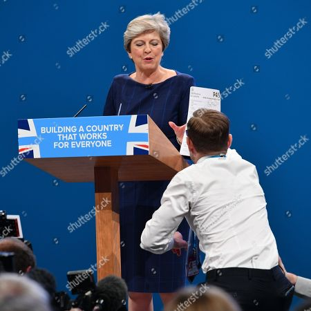 Theresa May Prankster Simon Brodkin Aka. Lee Nelson Hands Pm Theresa May A P45 During Her Keynote Speech At The Conservative Party Conference At Manchester Central Convention Centre Greater Manchester.