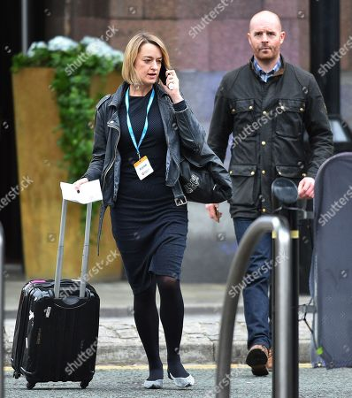 Editorial picture of Laura Kuenssberg. Bbc Political Editor Laura Kuenssberg And Security Guard 'al' Leave The Midland Hotel. - Conservative Party Conference At Manchester Central Convention Centre Greater Manchester. Pic Bruce Adams / Copy Lobby / 4/10/17.
