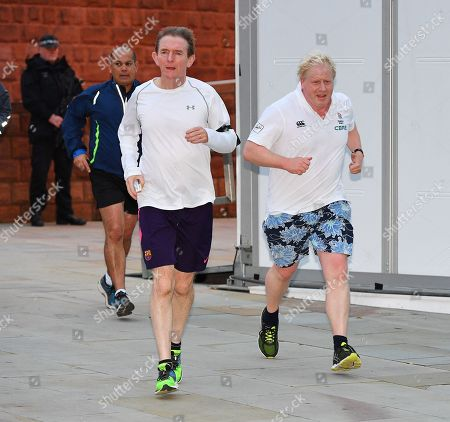 Editorial picture of Boris Johnson. Foreign Sec. And Rt Hon Boris Johnson Mp (r) Goes Jogging With Tony Gallagher (l). - Conservative Party Conference At Manchester Central Convention Centre Greater Manchester.