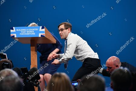 PM Theresa May Keynote Speech. Conservative Party Conference At Manchester Central Convention Centre Greater Manchester. Comedian Lee Nelson Hands Theresa May Her P45. 4/10/17.