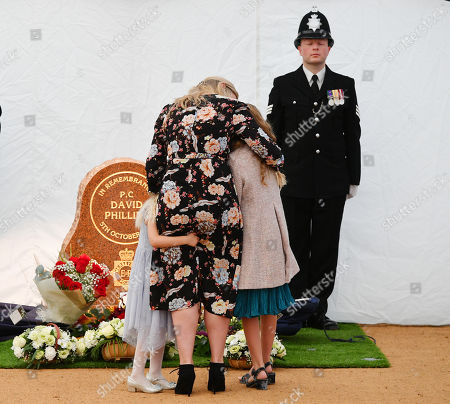 Jennifer Phillips .  - 12/10/17 Wife Jennifer Phillips With Daughters Abigail And Sophie Lay Flowers At A New Memorial To PC David Phillips Of Merseyside Police As It Is Unveiled At Hamilton Square Gardens Birkenhead Merseyside.