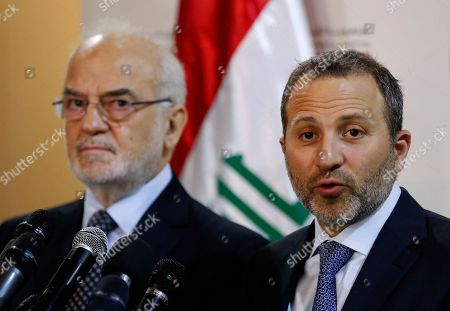 Ibrahim al-Jaafari, Gibran Bassil. Lebanese Foreign Minister Gibran Bassil, right, speaks during a press conference with his Iraqi counterpart Ibrahim al-Jaafari, in Beirut, Lebanon