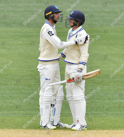 Trent Copeland (L) from the Blues celebrates 50 runs with Sean Abbott from the Blues during the JLT Sheffield Shield match between South Australia and New South Wales at Adelaide Oval in Adelaide, Australia, 17 October 2018.