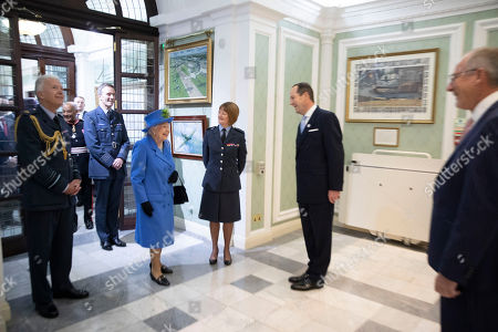 Queen Elizabeth II walks through the RAF Club with Air Marshall Sir David Walker, Air Vice Marshall Sue Gary and Group Captain Mark Heffron