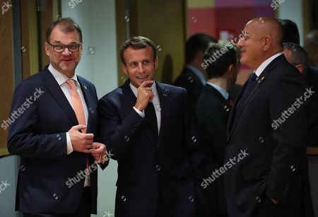 Finland's Prime Minister Juha Sipila, French President Emmanuel Macron and Bulgaria's Prime Minister Book Borissov at the start of the European Council summit in Brussels, Belgium, 17 October 2018. European Union leaders will meet during a dinner to discuss a possible Brexit.