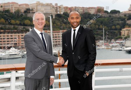The new headcoach of AS Monaco, Thierry Henry (R), and vice president Vadim Vasilyev (L) pose for photographers after a press conference at the at Yacht Club in Monaco, 17 October 2018.