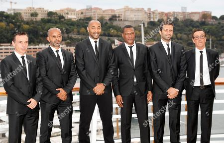 Stock Photo of The new headcoach of AS Monaco, Thierry Henry (3-L) poses with his staff Carlos Spignoli (L), Patrick Kwame (2-L), Michael Emenalo (3-R), Joao Tralhao (2-R) and Andre Amitrano (R) after a press conference at the Yacht Club in Monaco, 17 October 2018.