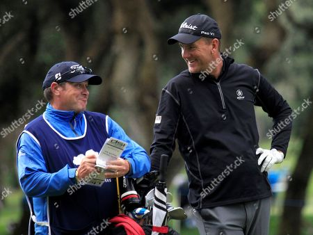 Swedish golfer Robert Karlsson (R) talks to his caddie (L), during the Andalucia Valderrama Master at Valderrama golf course in Cadiz, Andalusia, Spain, 18 October 2018. The tournament runs from 18 to 21 October.