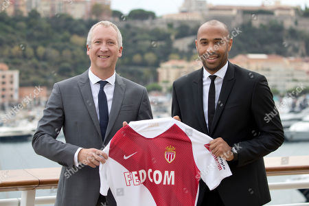 New AS Monaco head coach Thierry Henry, right, poses with AS Monaco Vice President Vadim Vasilyev during his official media presentation at the Monaco Yacht Club, . France's all-time leading scorer and an Arsenal great landed his first managerial job on Saturday after Monaco hired him as a replacement for Leonardo Jardim, who was dismissed this week