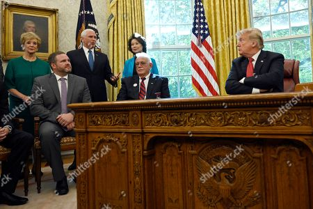 """Linda McMahon, Benson Waller, Mike Pence, Elaine Chao, David Boyer, Donald Trump. President Donald Trump, right, listens to Vice President Mike Pence, third from left, during a meeting in the Oval Office of the White House in Washington, with workers. The meeting with workers was, """"Cutting the Red Tape, Unleashing Economic Freedom."""" Joining in the meeting are, from left, Small Business Administrator Linda McMahon, miner Benson Waller, Pence, Transportation Secretary Elaine Chao, and professional truck driver David Boyer"""