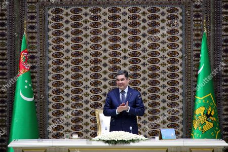 Turkmenistan's President Gurbanguly Berdymukhamedov applauds as he attends an opening ceremony of a chemical plant that cost $3.4 billion to build, its latest effort to diversity its gas-dependent economy, in Kiyanly, Turkmenistan, . The Turkmen government took on 15 percent of the plant's financing with the rest of the investments coming from Japan's Toyo Engineering and South Korea's LG International and Hyundai Engineering