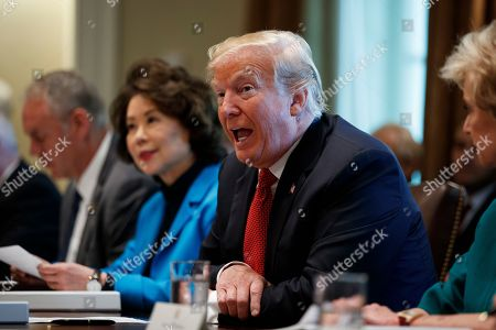 Donald Trump, Ryan Zinke, Elaine Chao, Linda McMahon. President Donald Trump speaks during a cabinet meeting in the Cabinet Room of the White House, in Washington. From left, Secretary of the Interior Ryan Zinke, Secretary of Transportation Elaine Chao, Trump, and Small Business Administration administrator Linda McMahon
