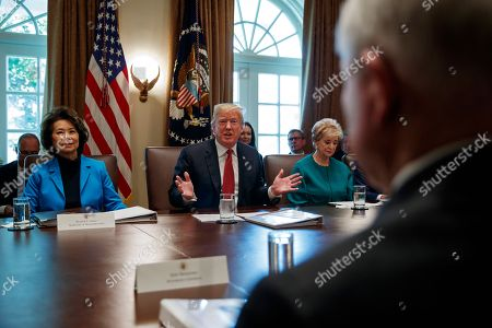 Donald Trump, Elaine Chao, Linda McMahon. Secretary of Transportation Elaine Chao, left, and Small Business Administration administrator Linda McMahon, right, listen as President Donald Trump speaks during a cabinet meeting in the Cabinet Room of the White House, in Washington