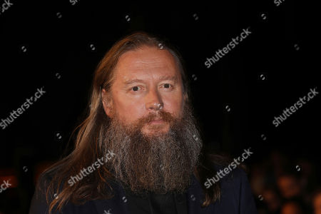 David Mackenzie poses for photographers upon arrival at the premiere of the film 'Outlaw King' showing as part of the BFI London Film Festival in London