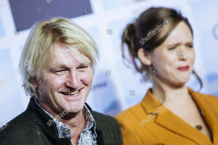 German director Detlev Buck (L) and British actress Emily Cox arrive for the German film premiere of 'Wuff' at the Zoo palast cinema in Berlin, Germany, 17 October 2018. The movie by German director Detlev Buck opens in German cinemas on 25 October 2018.