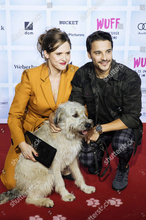 British actress Emily Cox (L) and German actor Kostja Ullmann arrive for the German film premiere of 'Wuff' at the Zoo palast cinema in Berlin, Germany, 17 October 2018. The movie by German director Detlev Buck opens in German cinemas on 25 October 2018.