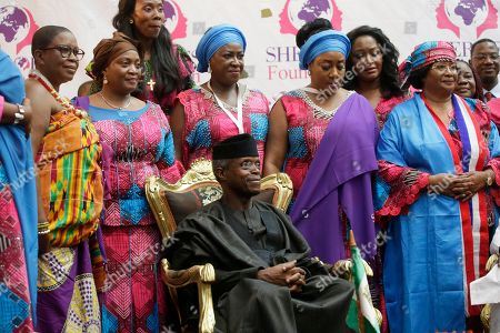 Stock Photo of Nigeria's vice president, Oluyemi Oluyeke Osinbajo (C), Jowel Howard Taylo(B-2nd L), Vice president of Liberia, Joyce Banda(R) and others dignitaries pose for a photo after the  official opening ceremony  of the International Sheroes Forum 2018 at the Monrovia City Hall, Monrovia, Liberia, 17 October 2018. The International Sheroes Forum brings together leaders and personalities to discusses and bolster the influence of women on the African Continent and the World in general.