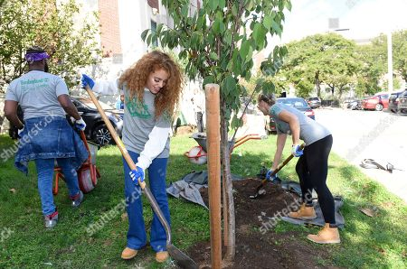 Stock Picture of Journeys and Timberland style ambassador Mahogany Lox lends a hand at Timberland's Urban Greening project at Manhattan Center for Science and Mathematics, in New York. Timberland has pledged to create or restore another 500,000 square feet of green space in U.S. cities over the next 5 years