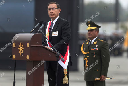 Peru's President Martin Vizcarra attends a ceremony marking the army's anniversary, in Lima, Peru. Vizcarra is on a crusade to clean up Peru's corrupt politics and become a voice for the poor and forgotten after his surprising ascension earlier this year with the resignation of ex-President Pedro Pablo Kuczynski over corruption allegations
