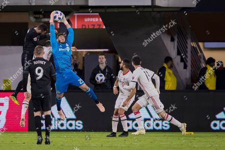 Toronto FC goalkeeper Alex Bono (25) makes a save during the MLS game between D.C. United and Toronto FC at Audi Field in Washington, District of Columbia