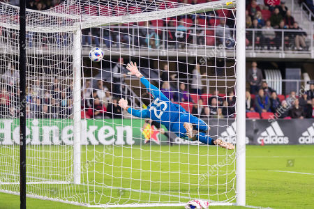 Stock Image of Toronto FC goalkeeper Alex Bono (25) is unable to make a save against D.C. United forward Wayne Rooney (9), not pictured, during the MLS game between D.C. United and Toronto FC at Audi Field in Washington, District of Columbia