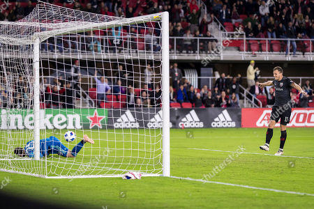 Stock Photo of D.C. United defender Frederic Brillant (13) celebrates a goal by forward Wayne Rooney (9), not pictured, against Toronto FC goalkeeper Alex Bono (25) during the MLS game between D.C. United and Toronto FC at Audi Field in Washington, District of Columbia