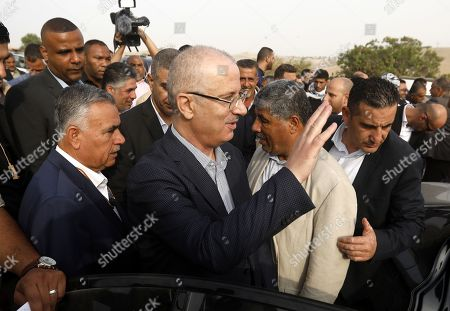 Palestinian Prime Minister Rami Hamdallah (C) visits the Palestinian Bedouin village of Khan al-Ahmar, located between the West Bank city of Jericho and Jerusalem near the Israeli settlement of Maale Adumim, 18 October 2018. Khan al-Ahmar is a Bedouin community where some 180 people live in shacks, that Israeli authorities claim were built without obtaining permits. Israeli authorities plan to demolish the shacks after the Israeli High Court of Justice rejected petitions filed by Khan al-Ahmar residents against their evacuation.