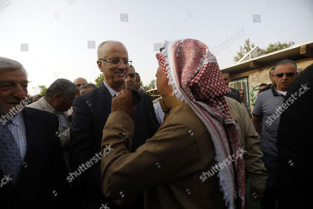 Palestinian Prime Minister Rami Hamdallah (C-L) visits the Palestinian Bedouin village of Khan al-Ahmar, located between the West Bank city of Jericho and Jerusalem near the Israeli settlement of Maale Adumim, 18 October 2018. Khan al-Ahmar is a Bedouin community where some 180 people live in shacks, that Israeli authorities claim were built without obtaining permits. Israeli authorities plan to demolish the shacks after the Israeli High Court of Justice rejected petitions filed by Khan al-Ahmar residents against their evacuation.