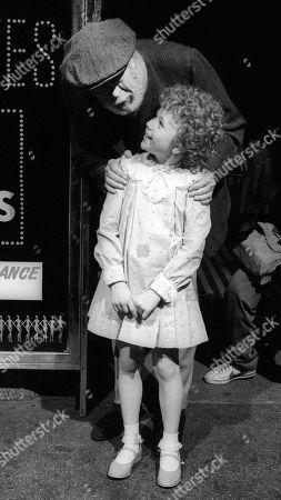 Aileen Quinn and John Huston