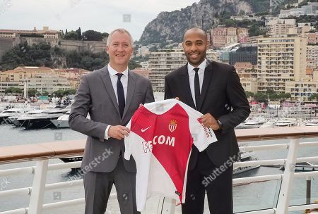 Monaco AS vice president Vadim Vasilyev (L) and former player Thierry Henry, new coach of the football club of Monaco, pose as part of a presentation to the press in Monaco