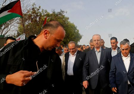 Stock Image of Palestinian Prime Minister Rami Hamdallah, third right, visits to the West Bank hamlet of Khan al-Ahmar, . Israel's Supreme Court recently rejected a final appeal against plans to demolish the village. Israel says Khan al-Ahmar was built illegally and has offered to resettle its residents a few miles (kilometers) away. Palestinians and other critics say the demolition aims to displace Palestinians in favor of Israeli settlement expansion
