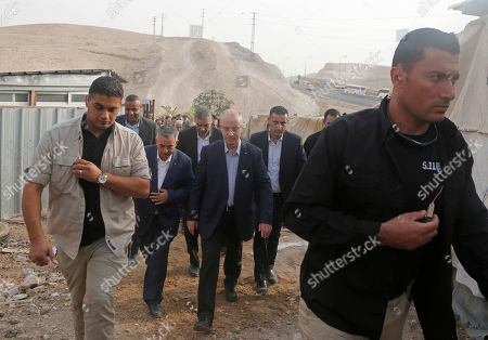 Stock Picture of Palestinian Prime Minister Rami Hamdallah, third right, visits the West Bank hamlet of Khan al-Ahmar, . Israel's Supreme Court recently rejected a final appeal against plans to demolish the village. Israel says Khan al-Ahmar was built illegally and has offered to resettle its residents a few miles (kilometers) away. Palestinians and other critics say the demolition aims to displace Palestinians in favor of Israeli settlement expansion