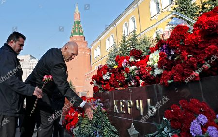 Russian parliament deputy Nikolai Valuev, a former professional heavyweight boxer (R) lays flowers on the monument to the hero-city of Kerch in the Alexander Garden, Moscow, Russia, 18 October 2018, as a sign of mourning for the victims of the attack at a vocational school in Kerch in Crimea, on 17 October 2018. Reports state that 18-year-old gunman student, Vladislav Rosliakov committed suicide after killing 20 students and teachers and injuring 74 others during the attack at the school in Kerch on 17 October 2018.